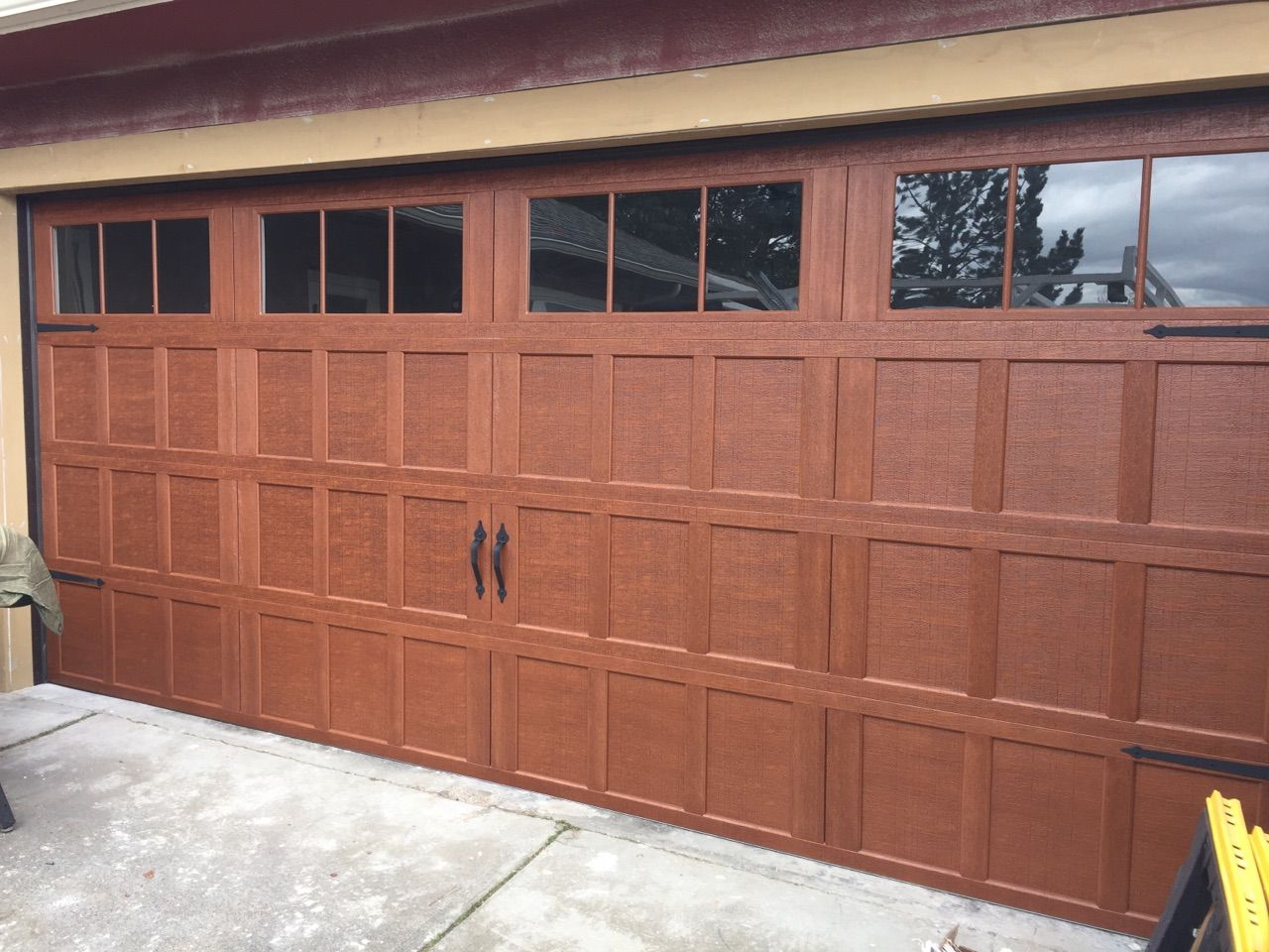 hight resolution of wayne dalton carriage house providence style stained honduran mahogany 12 lite square top glass