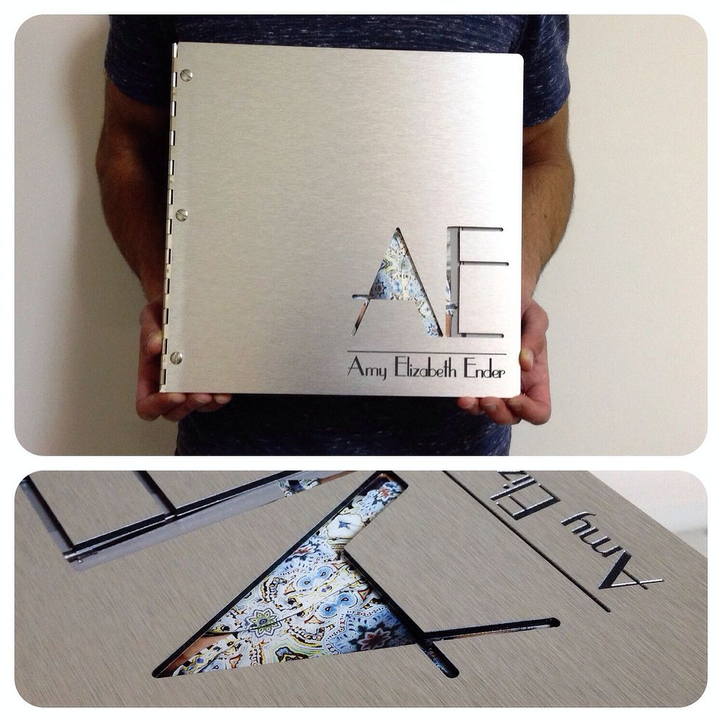 Custom Graphic Design Portfolio Book On Brushed Silver Aluminum With Cut Out And Engraving