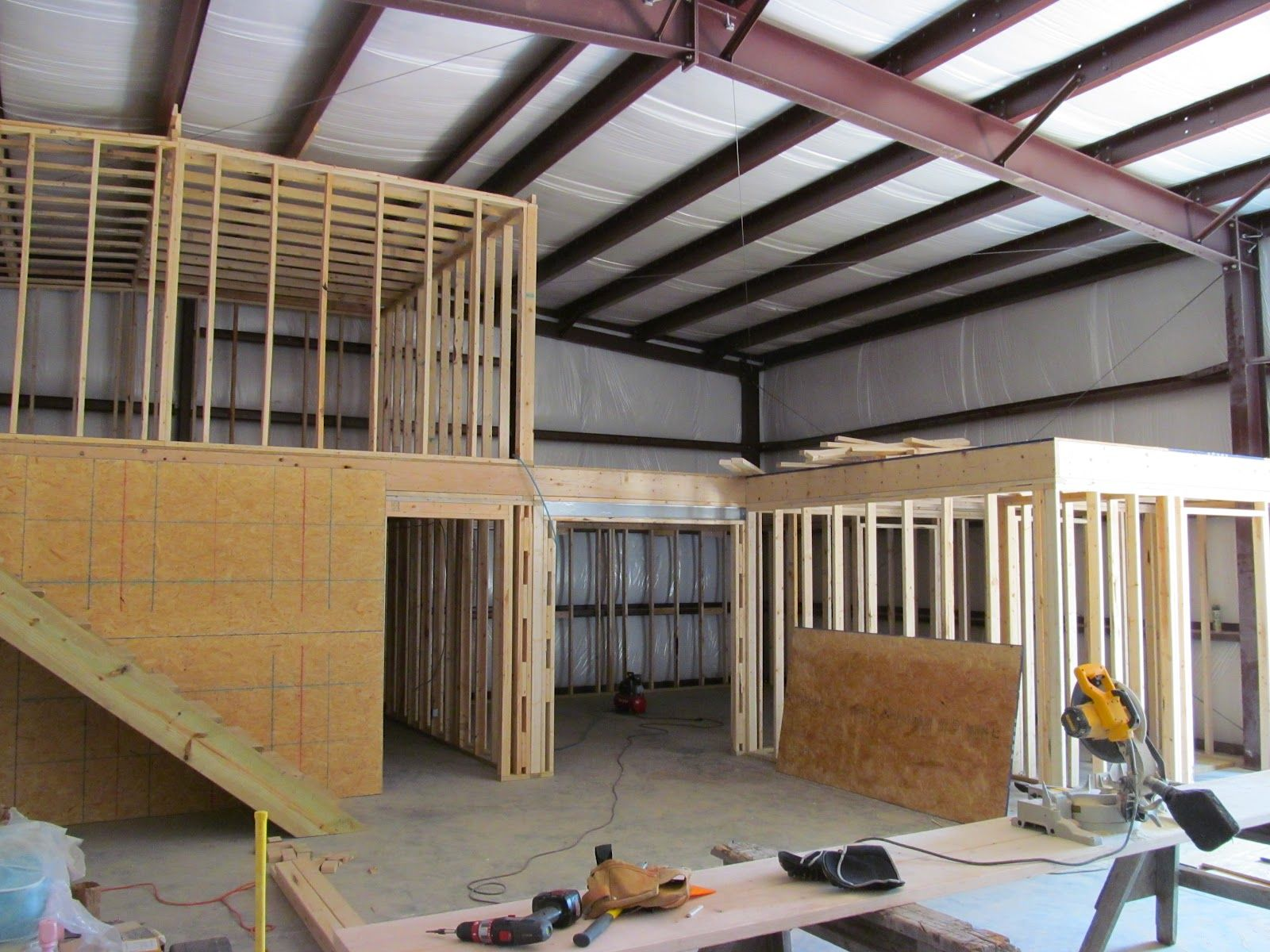 The inside framing of a metal building converted into a for Shop with apartment