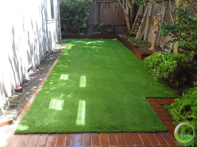 Artificial grass dog run w brick border plant bamboo in for Garden sectioning ideas