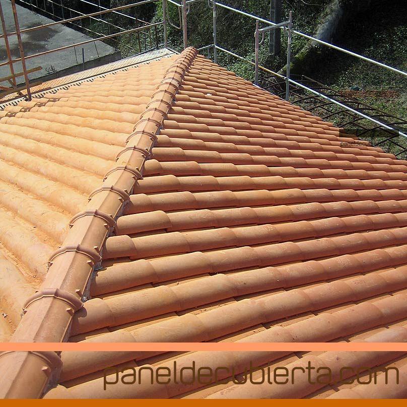 Cubiertas de teja sobre panel y estructura de madera for Tejados de madera