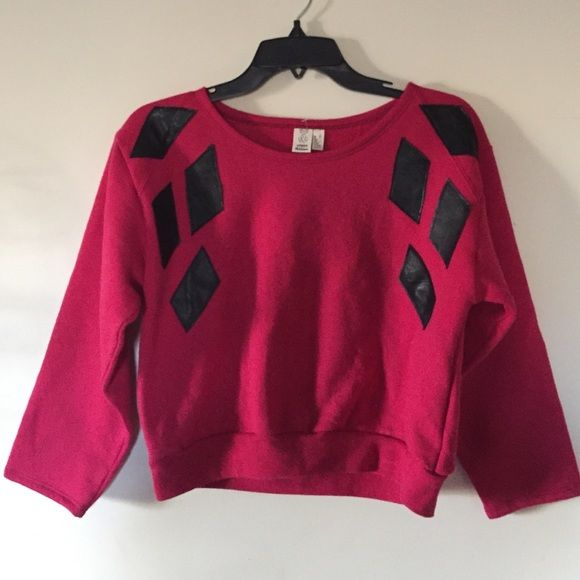 Urban Renewal Crop Sweatshirt Super cute pink crop sweatshirt from urban renewal. Has a leather diamond shapes sewn onto the top like an appliqué. Never worn basically brand new! 20 inches from armpit to armpit 18 inches from top of shoulder to bottom! Urban Outfitters Sweaters Crew & Scoop Necks