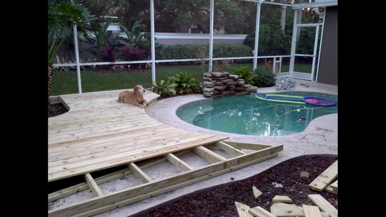 Ideas On How To Build A Custom Wood Deck Around Your In Ground Swimming Pool Wood Pool Deck Wooden Pool Deck Pool Deck Decorations