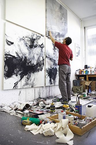 Love the natural light, and the freedom to make a great paint mess on the floor. This male artist is creating great black and white canvas work