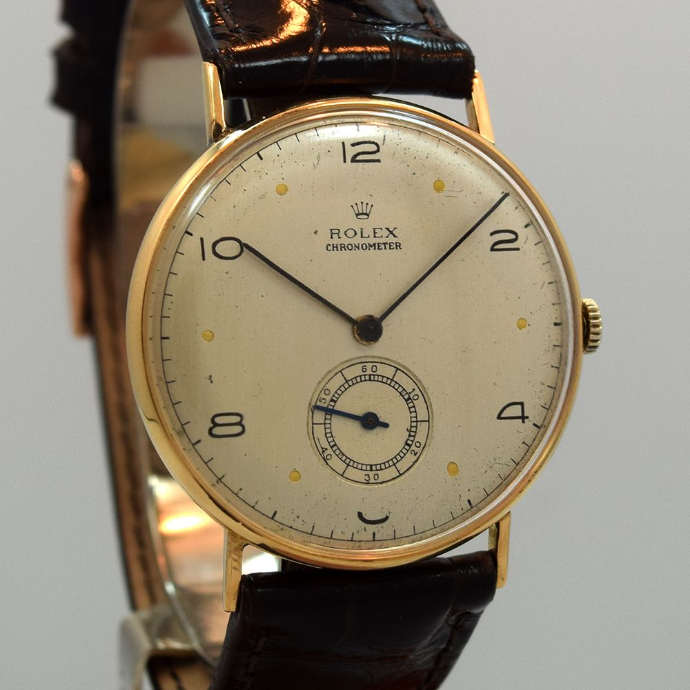 A 1940's era Rolex Chronometer Ref. 3625 of 14K Rose Gold that features a patinated silver dial with black Arabic numerals and applied, dot markers. This timepiece also comes equipped with a manual caliber, 17-jewel 10 1/2 Lignes movement. (Store Inventor #vintagewatches