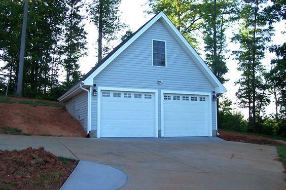 2 Car Garage With Bonus Room Built Into A Hillside Building A Garage Car Garage Garage Decor