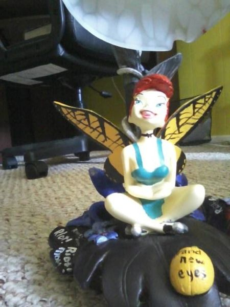 My old tinker bell lamp i painted to look like Hayley Williams from Paramore. Its not perfect but im proud of it:)