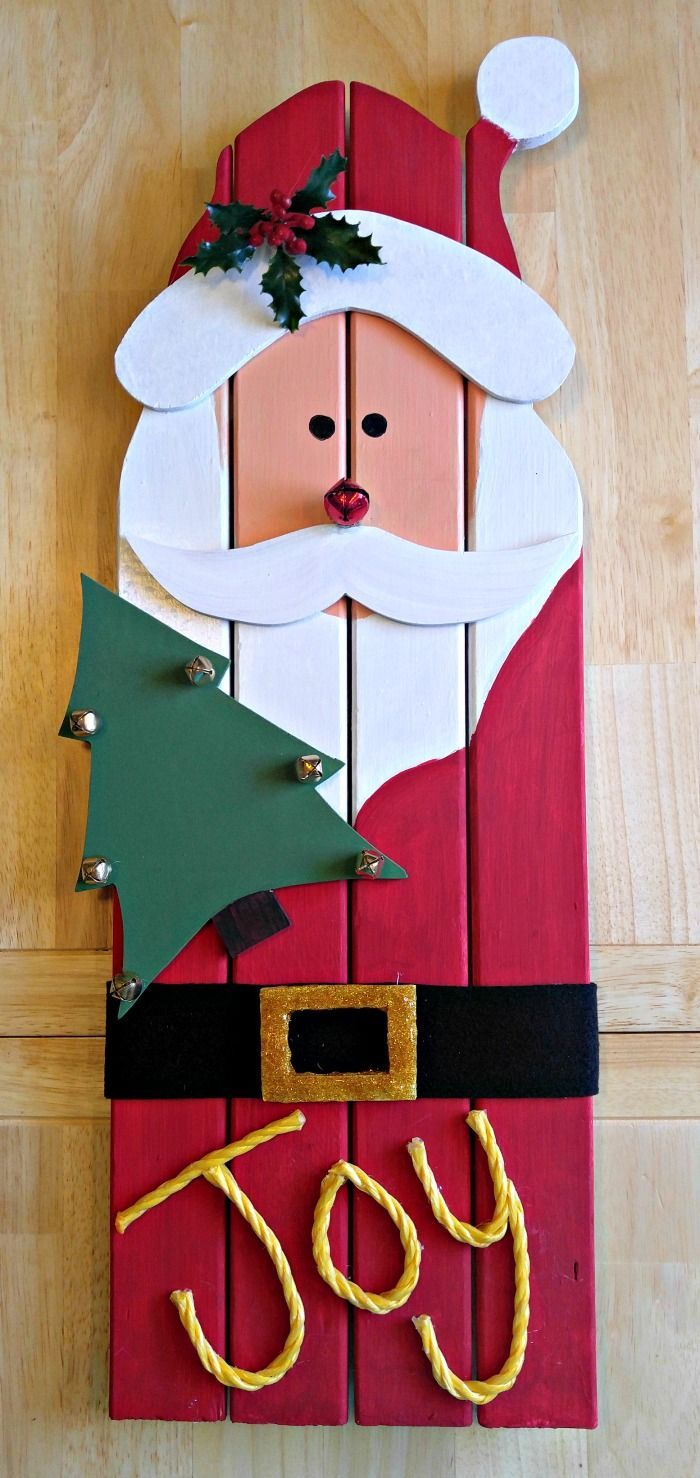 This reclaimed wood santa decoration is made from left over wood