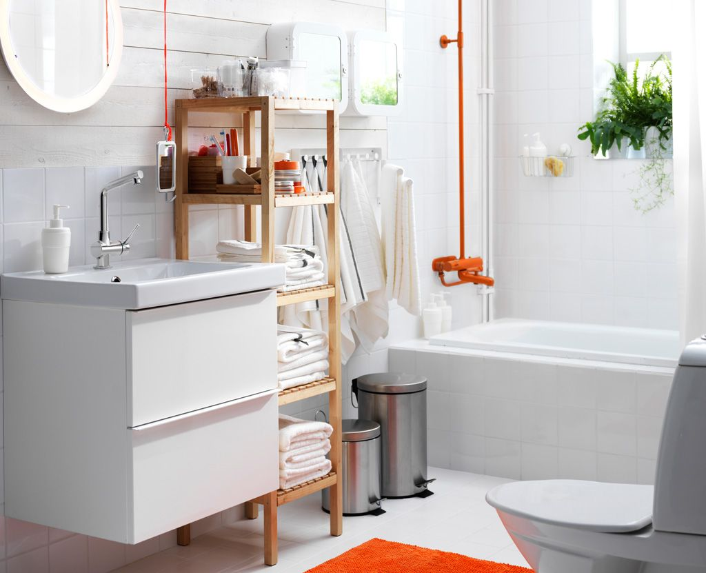 View of the bathroom. White suite and walls, wooden IKEA shelving ...