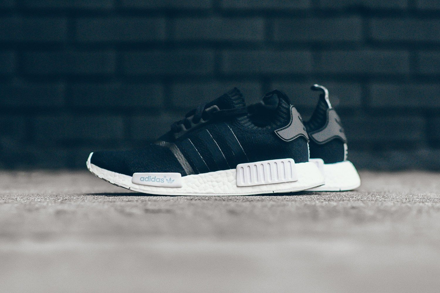4ddb837b4 adidas Originals Drapes the NMD R1 in a Tonal Black Upper