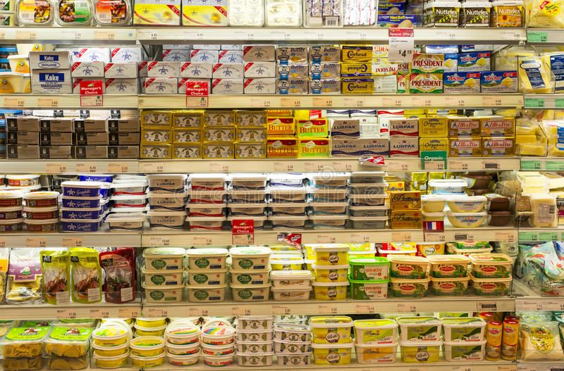 Butter and Margarine. Refrigerated shelves of butter and