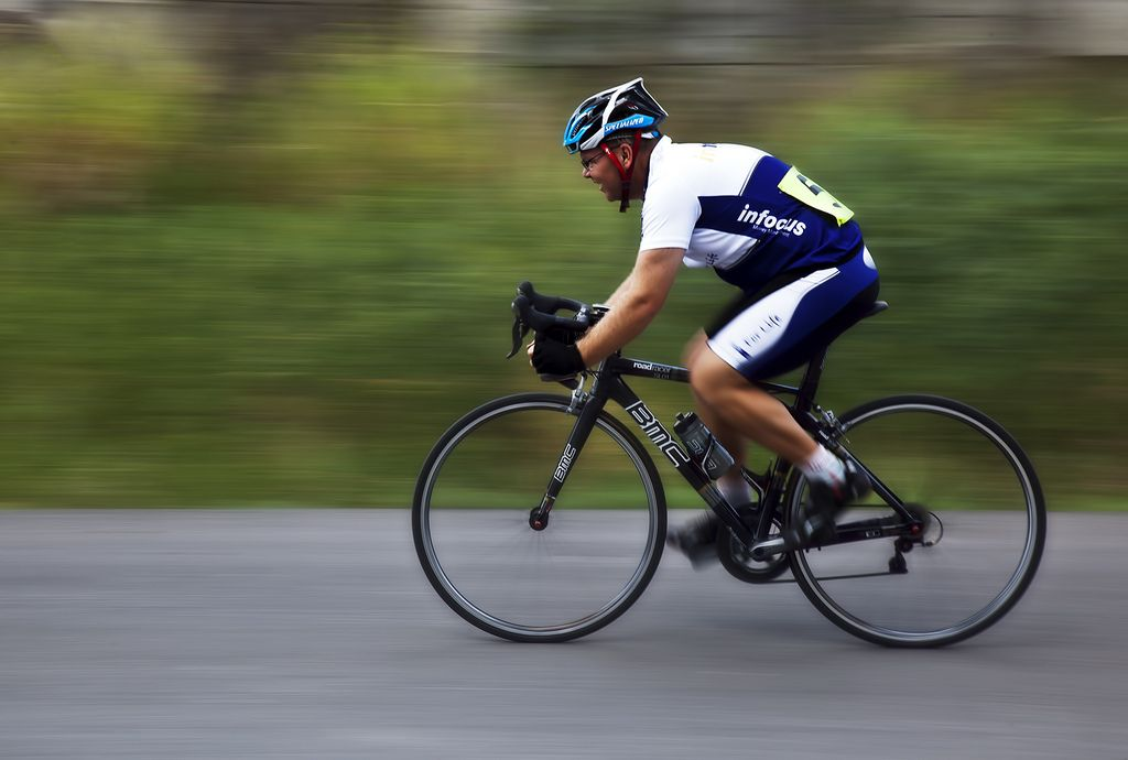 Photo Of Cyclist Riding On A Road Bike Belly Fat Burner Workout