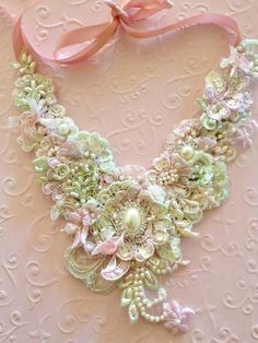 pastel necklace tied with a pretty ribbon