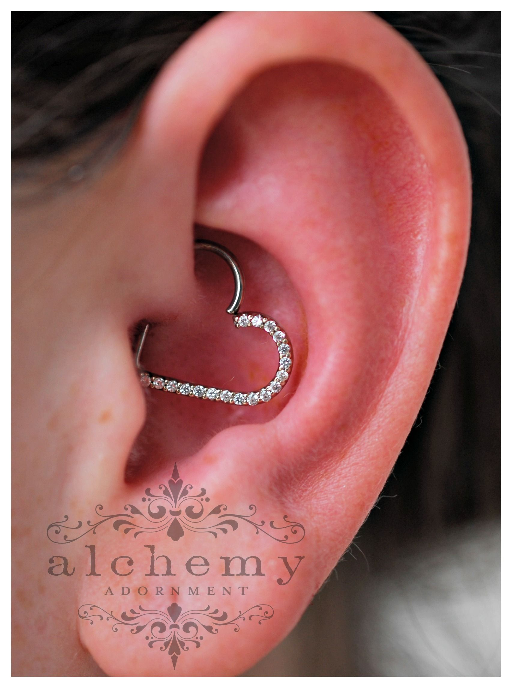 White piercing bump  Daith piercing by Bree with an  gem white gold heart by Alchemy