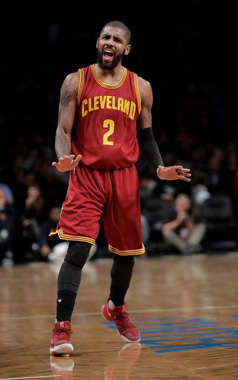 Cleveland Cavaliers   Kyrie Irving (2) gestures while talking to a fan  after shooting a three-point basket during the first half of an NBA  basketball game ... e105a2baba57