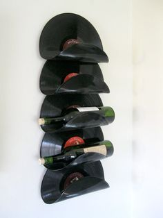 This is my prototype for a wall-hung wine rack made from old vinyl records. The records appear to float with no visible supports. On the back side, you can