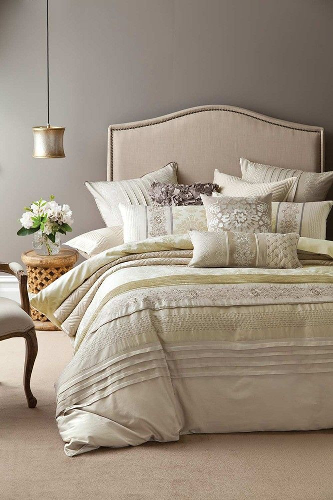 Bed linen Grey wall against light upholstered