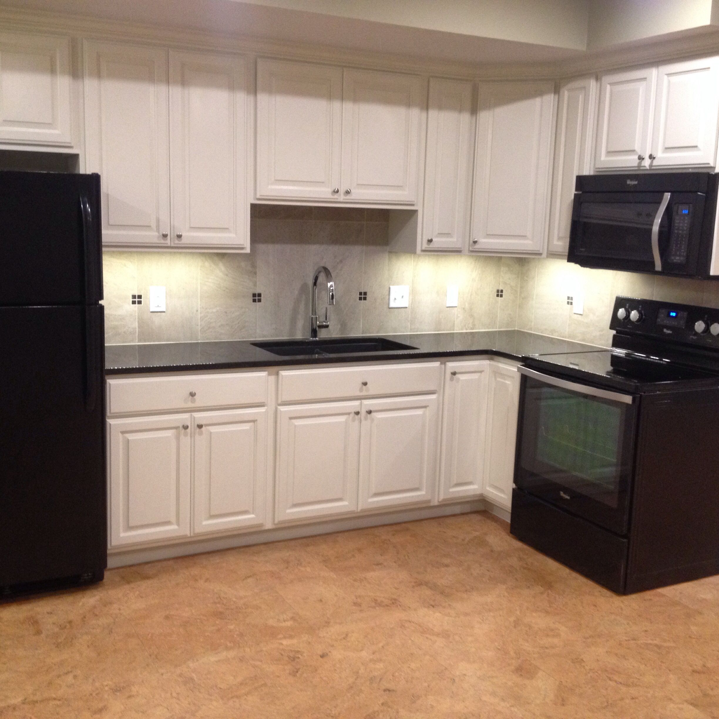 Undermount Lighting For Kitchen Cabinets: White Kitchen Cabinets, Black And Stainless Appliances