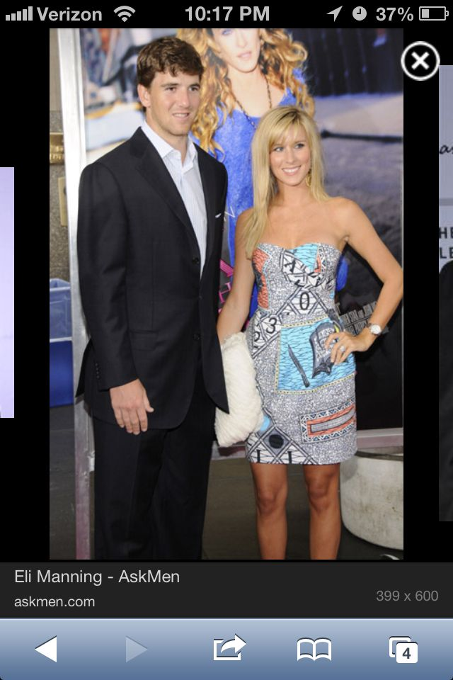 Mannings wife is actually cute!?! That dress... Seriously WANT!!!