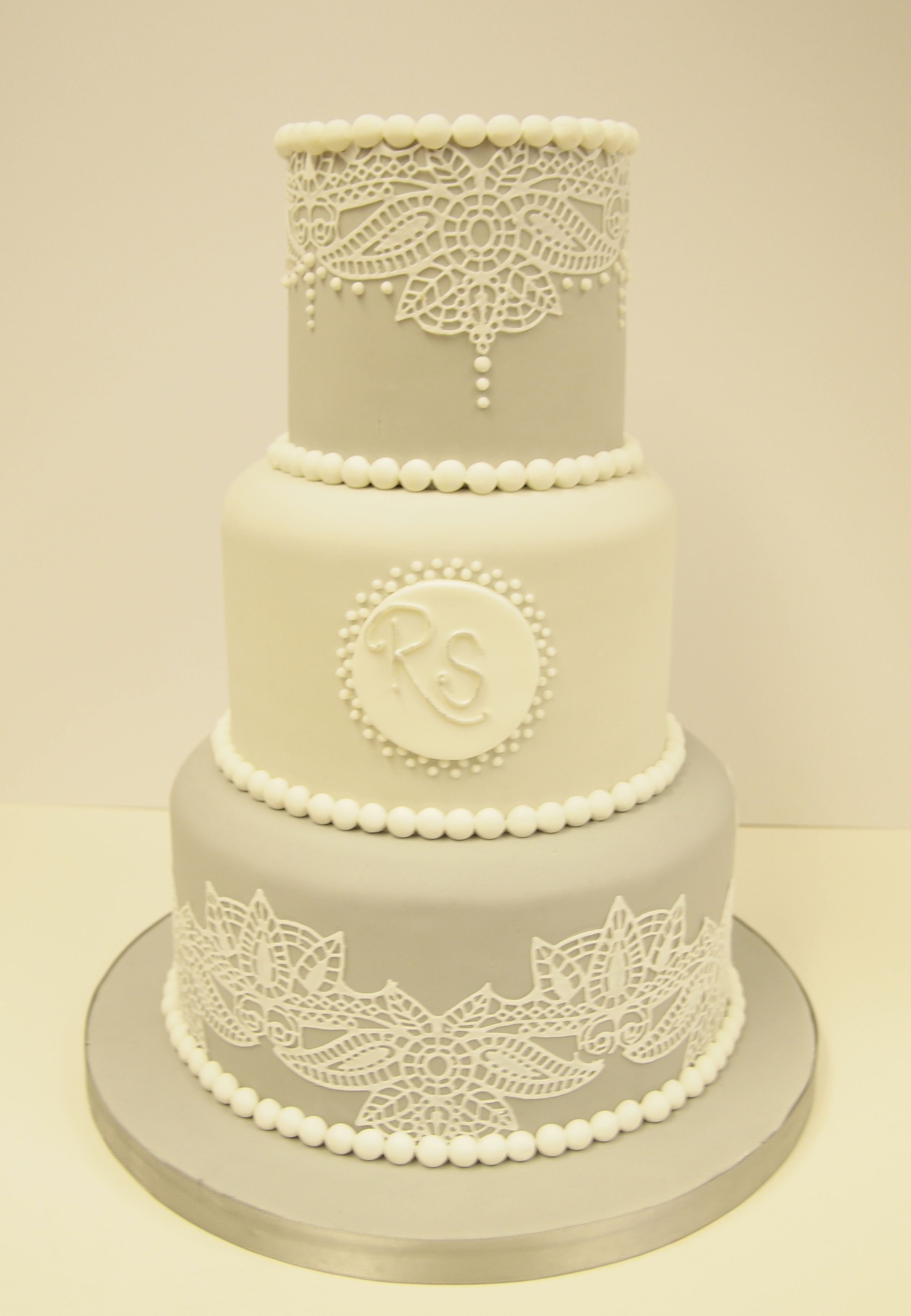A Three Tier Grey Wedding Cake with Edible Lace Detailing by Bath ...