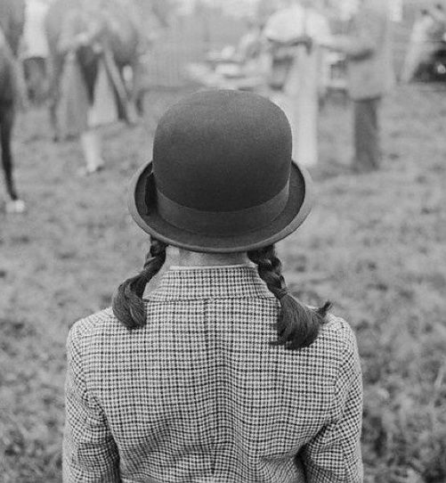 Girl in fox hunting attire for Town Magazine at a photo shoot in Unionville, PA. by Genevieve Naylor, 1955.
