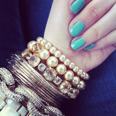 layered bracelets and turquoise nails :-)