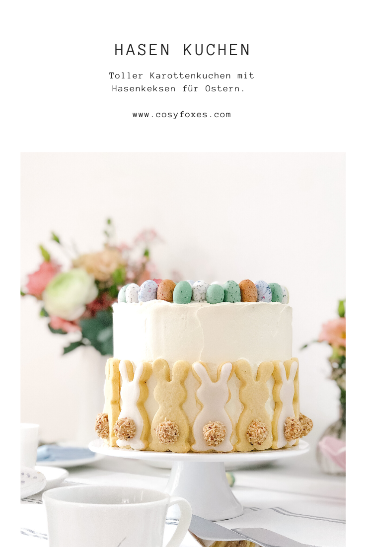 Carrot cake with rabbit biscuits for Easter