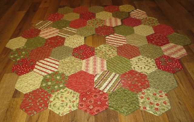 A Christmas tree skirt made with 4 inch paper hexagons so fun to