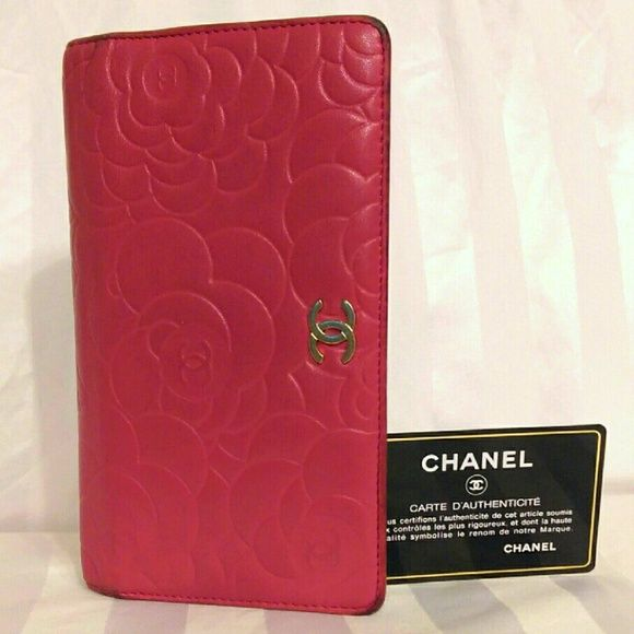 Authentic Chanel Quilted Pink Lambskin Wallet In good used condition.  All wear shown clearly in pics. All card slots and pockets are in Perfect condition,  no rips or tears.  Gorgeous color. CHANEL Bags Wallets