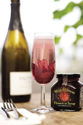 Wild Hibiscus Flowers In Syrup Makes A Great Garnish For Almost Any Drink And Adds A Touch Of Sweetness With Images Hibiscus Flowers Hibiscus Champagne Bubbles