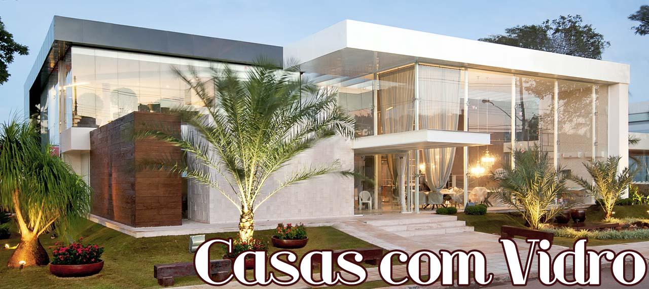 Fachadas de casas com vidro transparente verde azul for Fachadas de casas modernas com jardim
