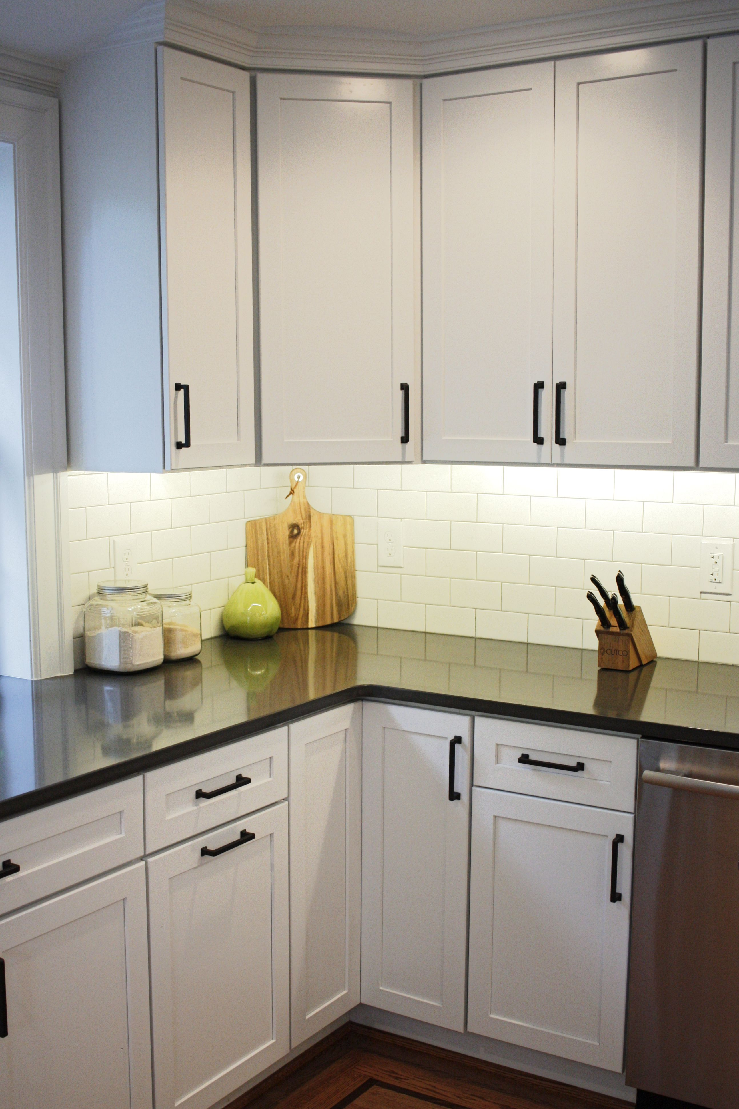 White cabinets subway tile backsplash by turner troxell in