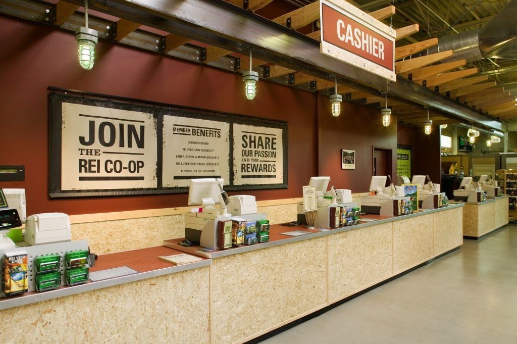 Rei Interior Cash Register Marlton Nj The Bannett Group Store Signage Interior Fit Out Red Accent Wall
