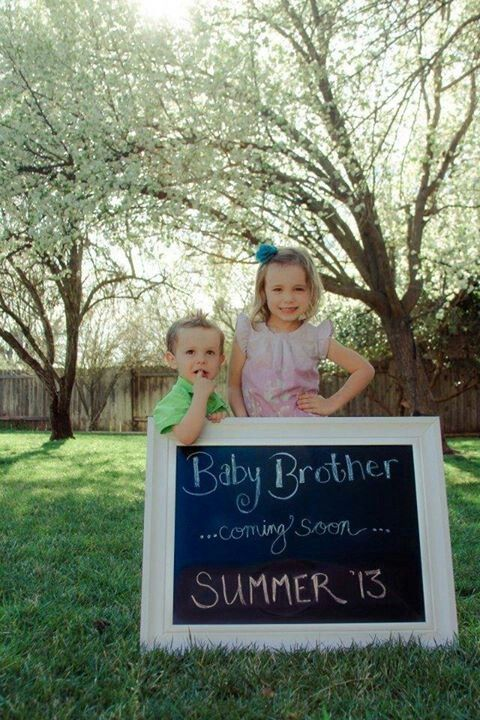 My sweet kids and our Baby Brother announcement