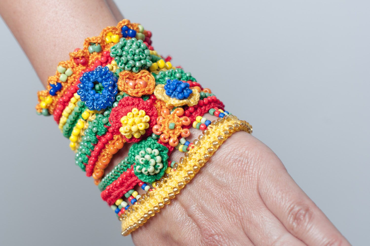 Colorful Crochet Cuff In Orange Red Green Blue Yellow With Beads by SvetlanaCrochet on Etsy https://www.etsy.com/listing/235347822/colorful-crochet-cuff-in-orange-red