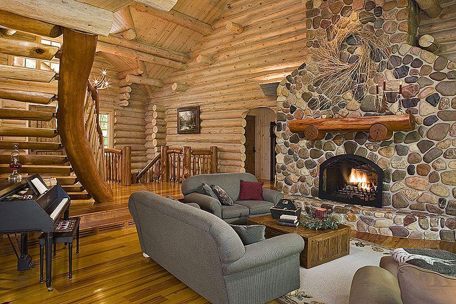 Cobblestone Fireplace log home living room with large giant cobblestone fireplace and