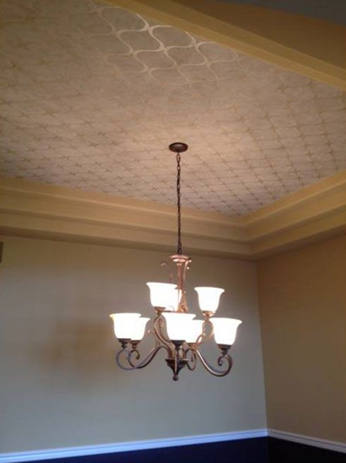 Wallpaper in a tray ceiling...or stencil with clear gloss