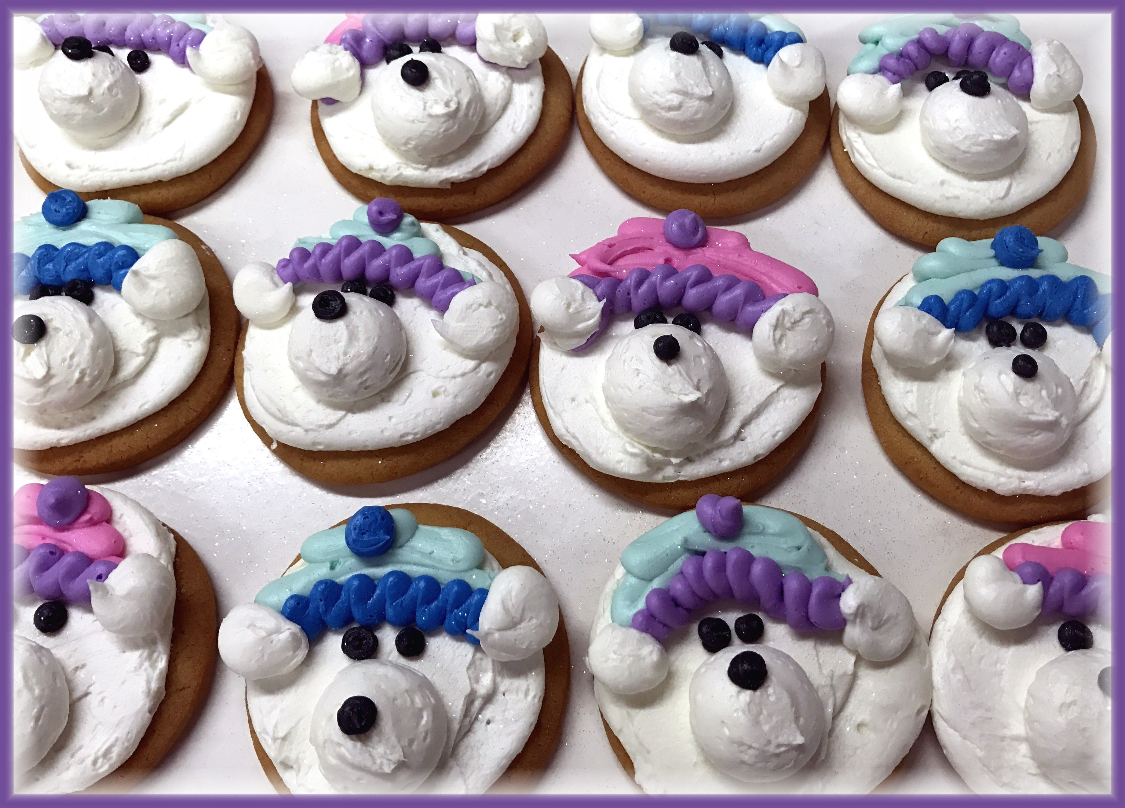 Hand decorated buttercream winter polar bear cookies by