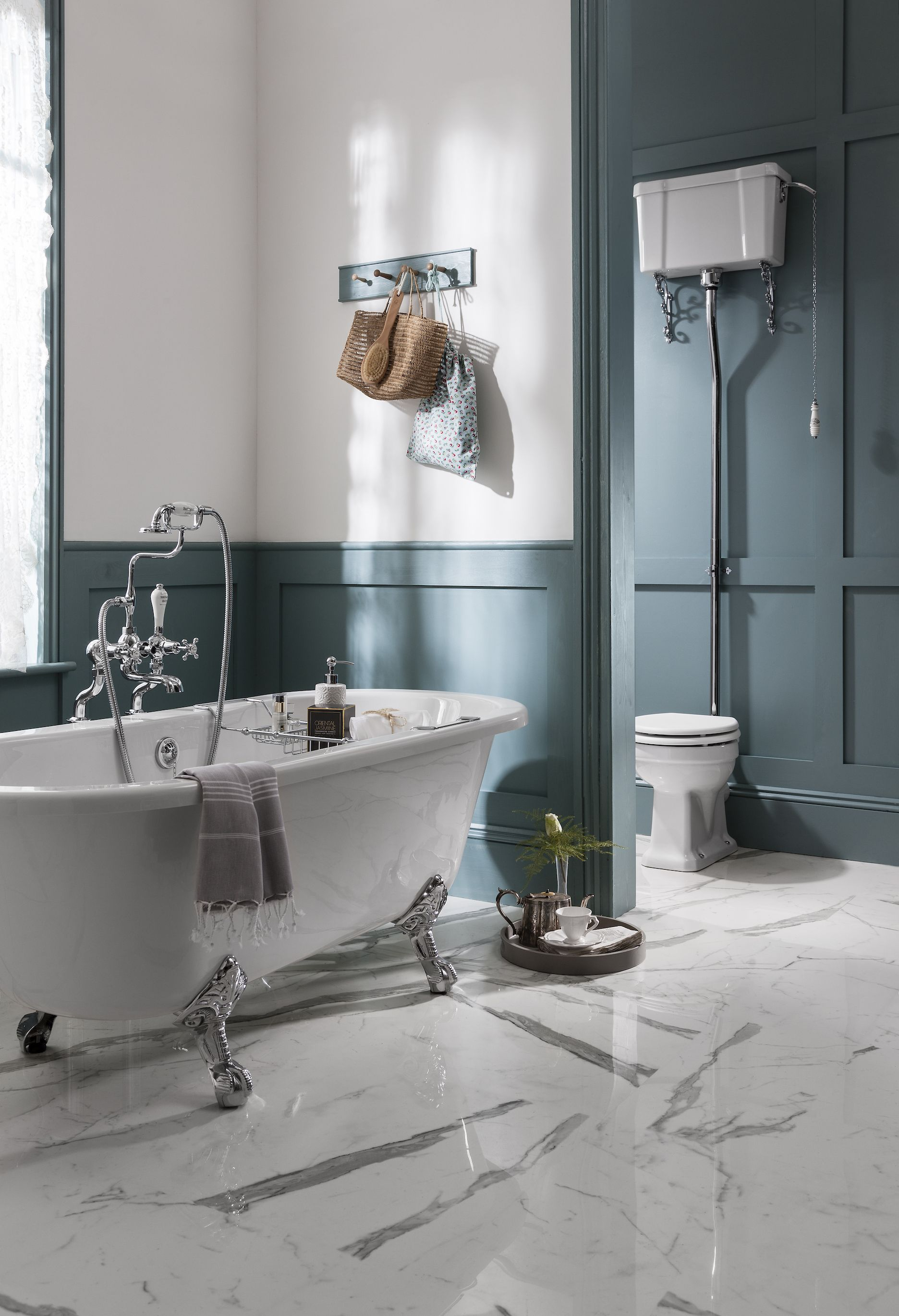 Panelled Walls Stand Alone Bath And Traditional Cistern