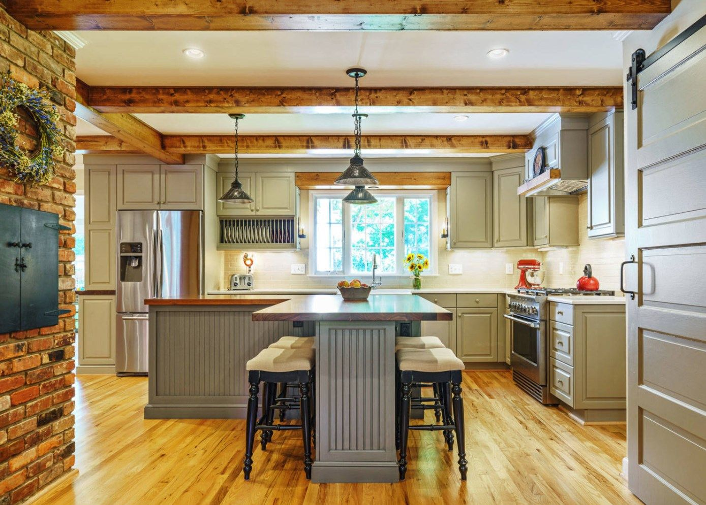 A Cramped Kitchen Gets A Touch Of Old World Charm And An Open Layout For A Large Active Family The Stunning Re Kitchen Remodel Feature Cabinets Grey Kitchens
