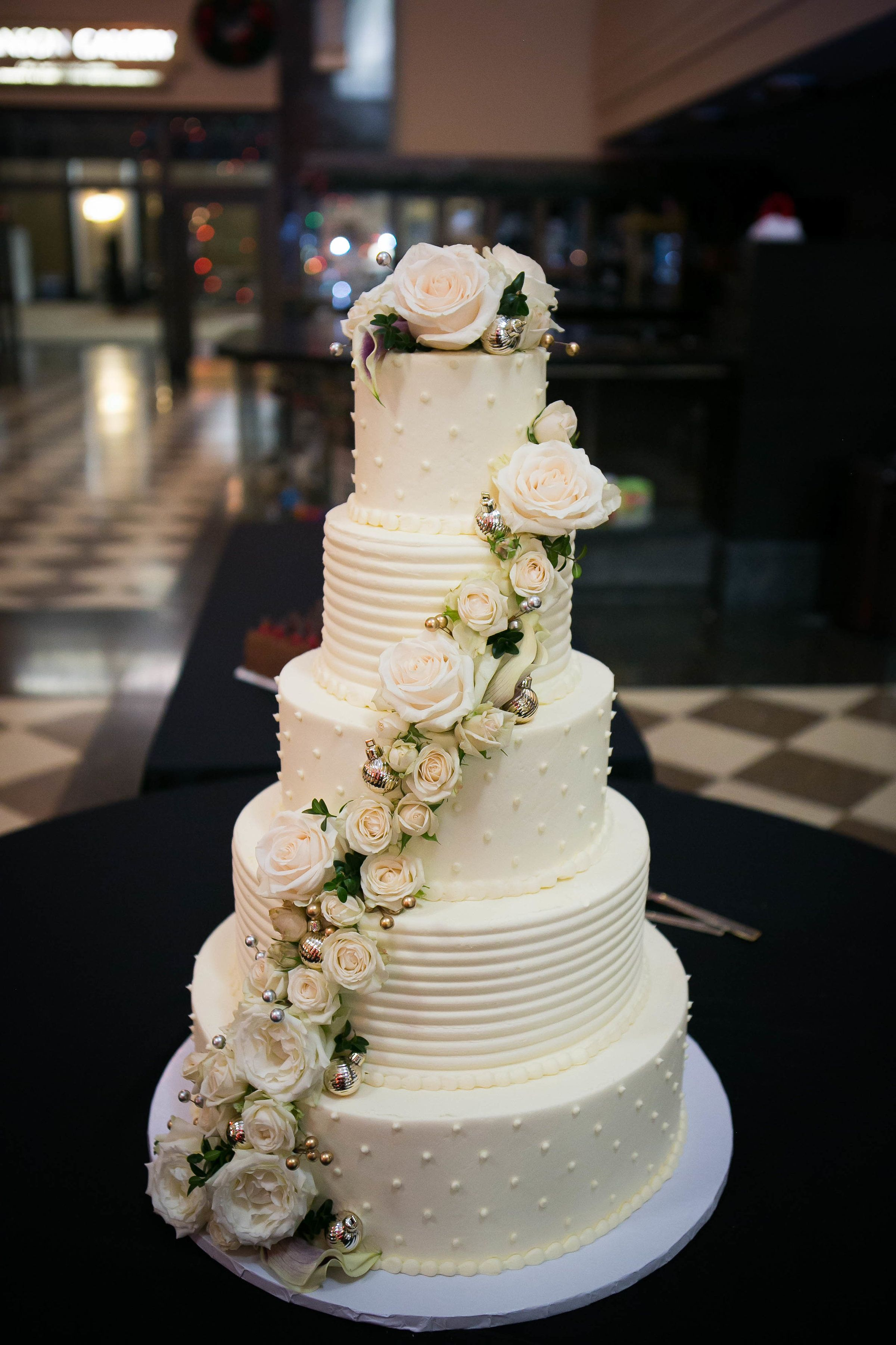 Five Tier Wedding Cake with Roses Omaha Wedding The Durham Museum - click to view full gallery