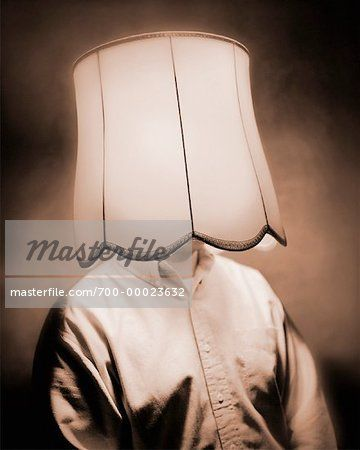 Man With Lampshade Over Head