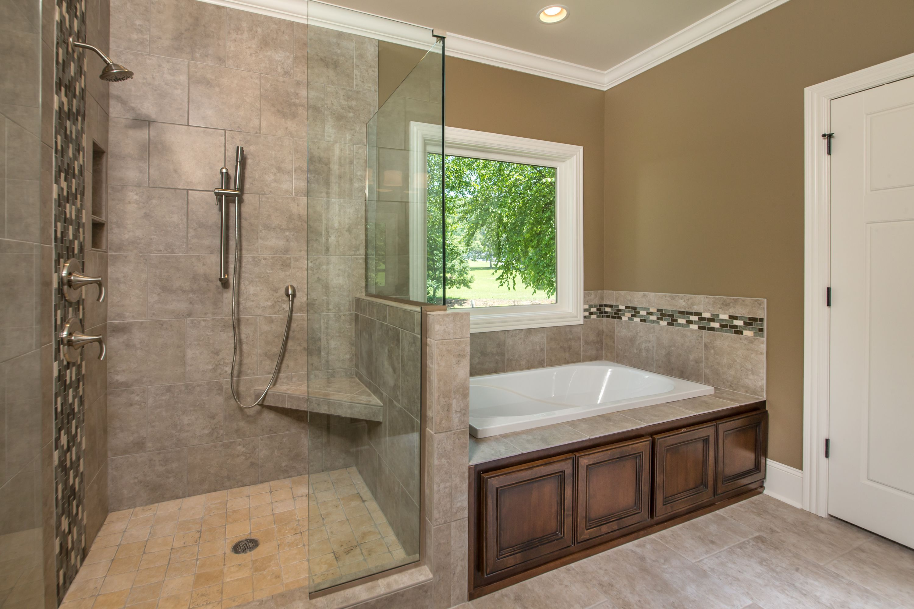 Master Bath Featuring A Garden Tub And Large Tiled Shower In Our
