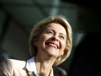German Defence Minister Von der Leyen smiles after evacuation following fire alarm during news conference in Berlin