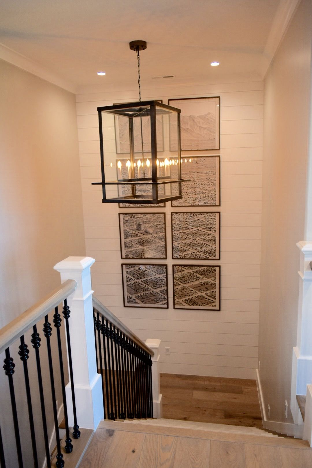 Basement Stair Landing Decorating: Artwork In Stairwell U-shaped Stairs