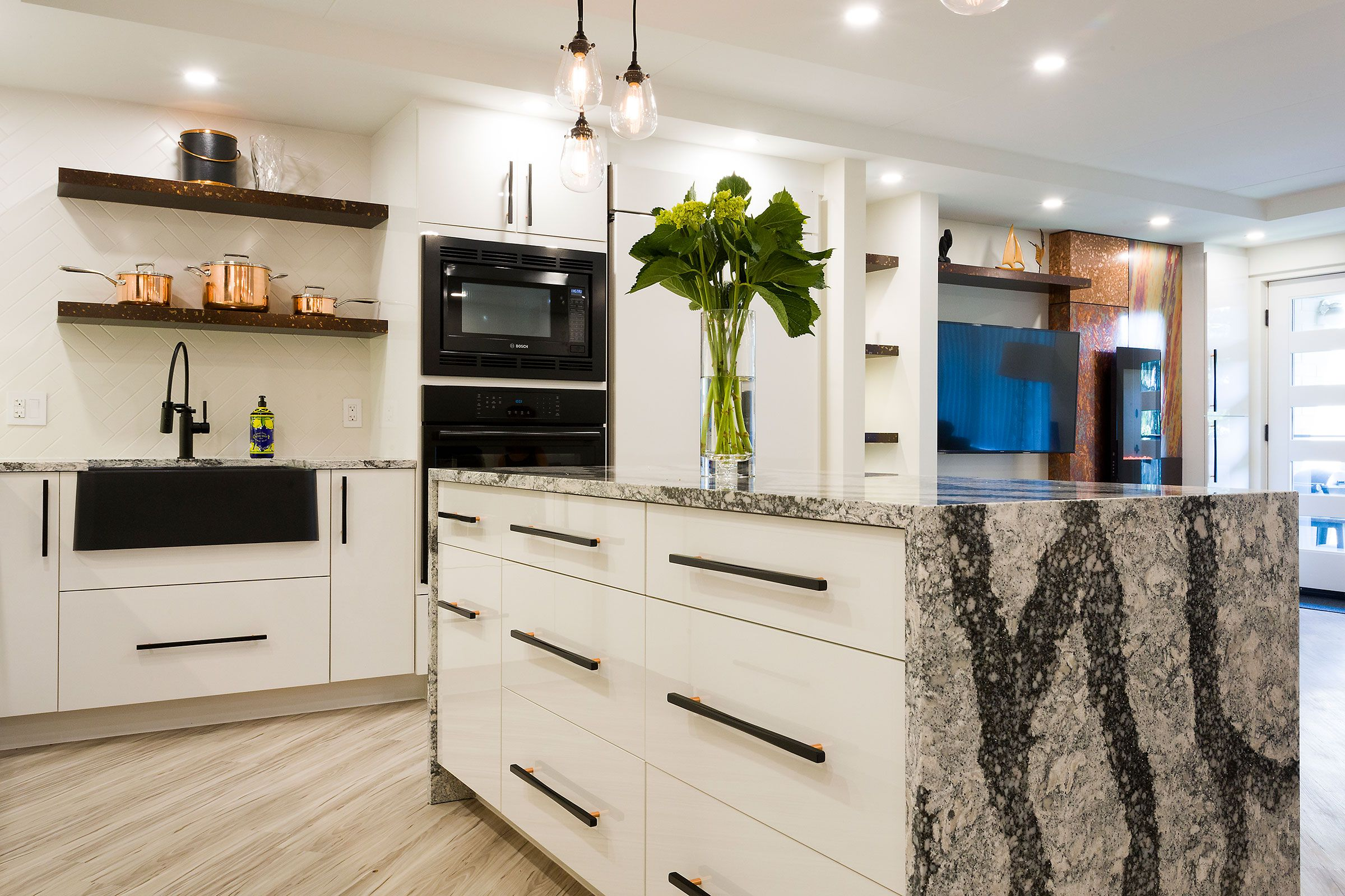 For this condo renovation, the walls between kitchen and living room ...
