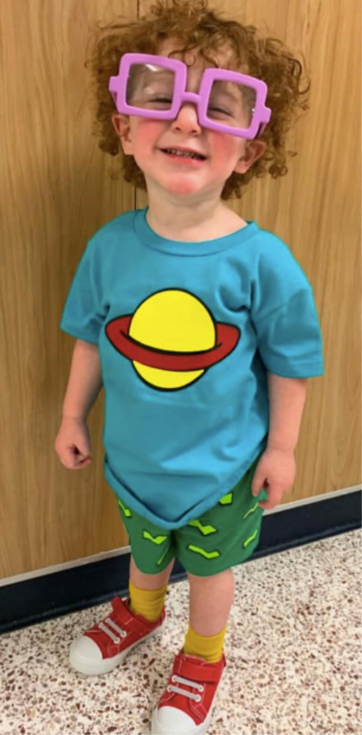 A Toddler Dressed Up as Chuckie From Rugrats For Halloween
