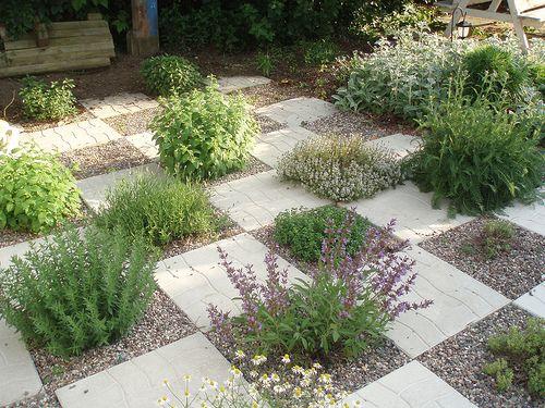 Herb garden planted checkerboard paving stones for Checkerboard garden designs