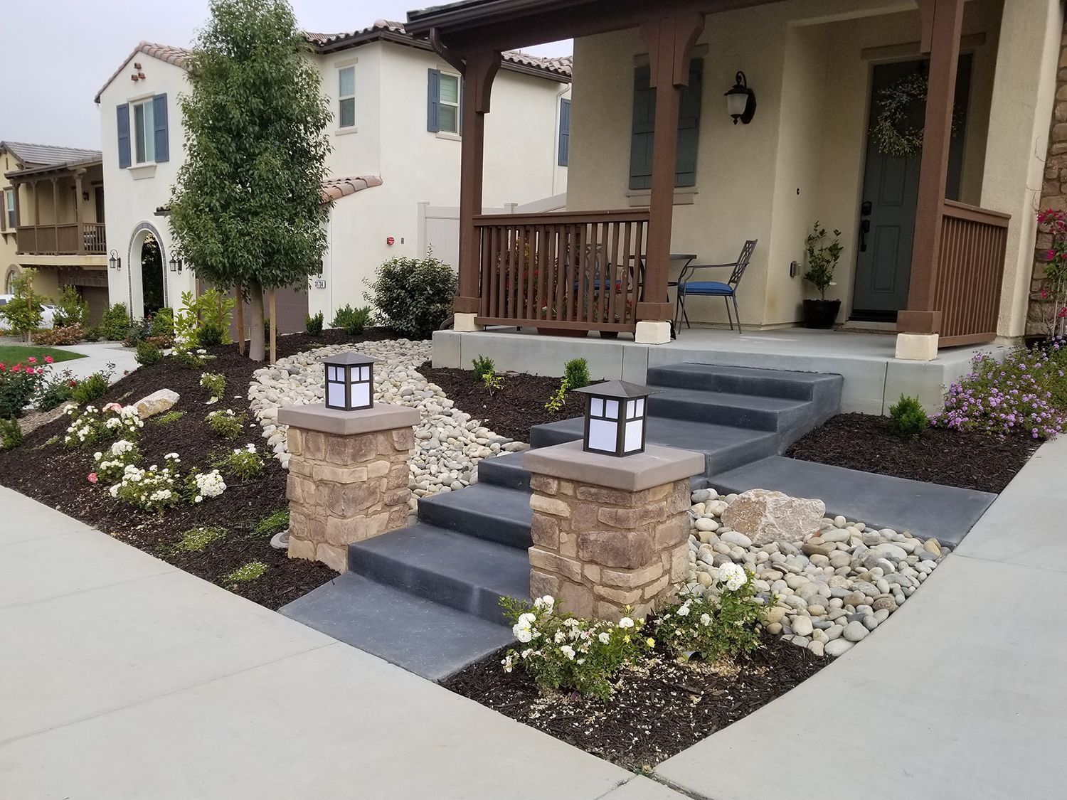 A Front Yard Landscape With A Dry River Deep Grey Concrete Steps | Front Yard Stairs Design | Entry | Uphill | Step | Residential | Main Door Stair