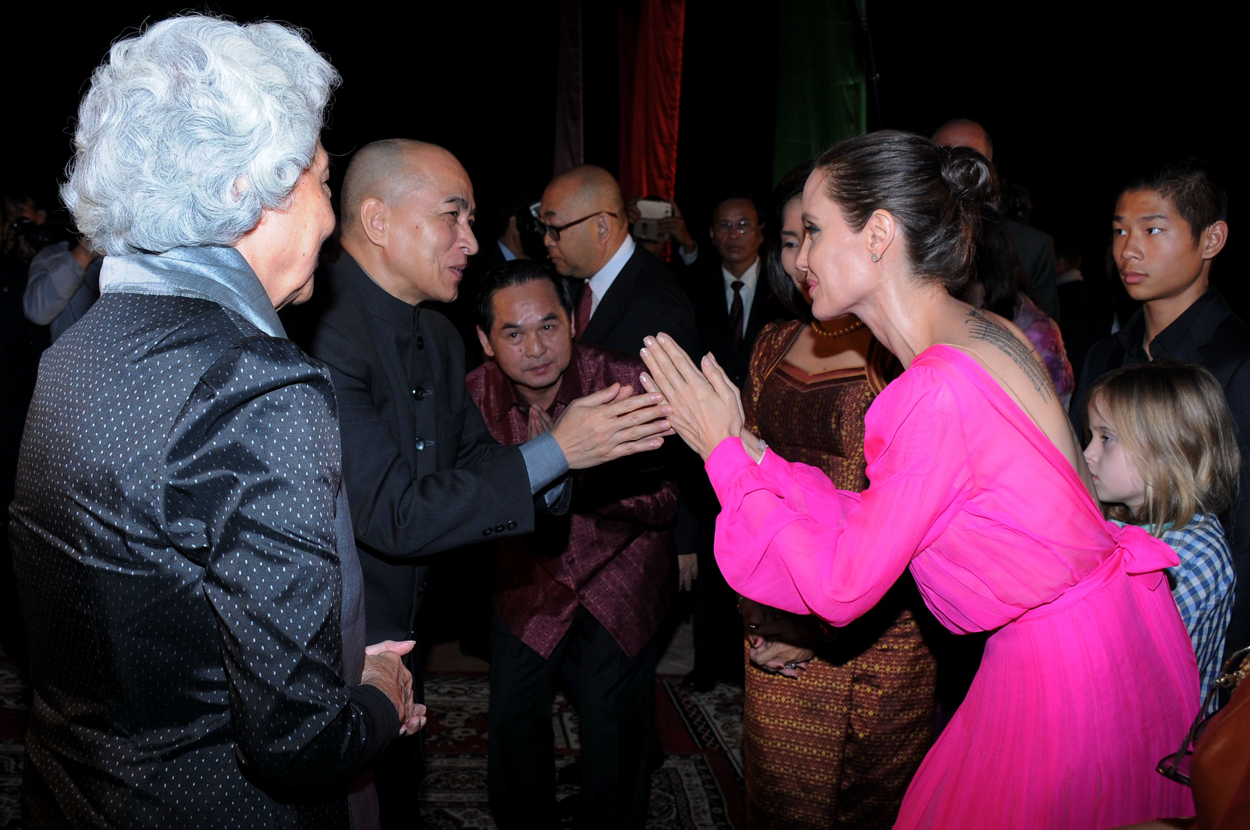 Angelina Jolie looked gorgeous in a hot pink gown in Cambodia, and we're  seriously feeling this look on her | Woman meme, Looking gorgeous, Flirting  moves